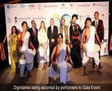 Dignitaries being escorted by performers to Gala Event